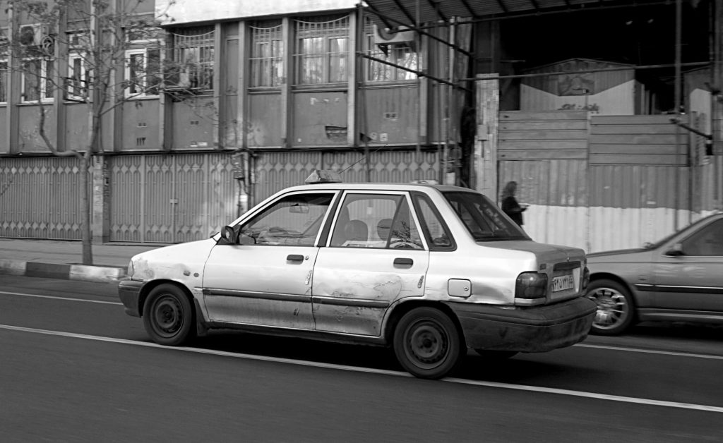 Saipa - A typical old and dented car in Iran