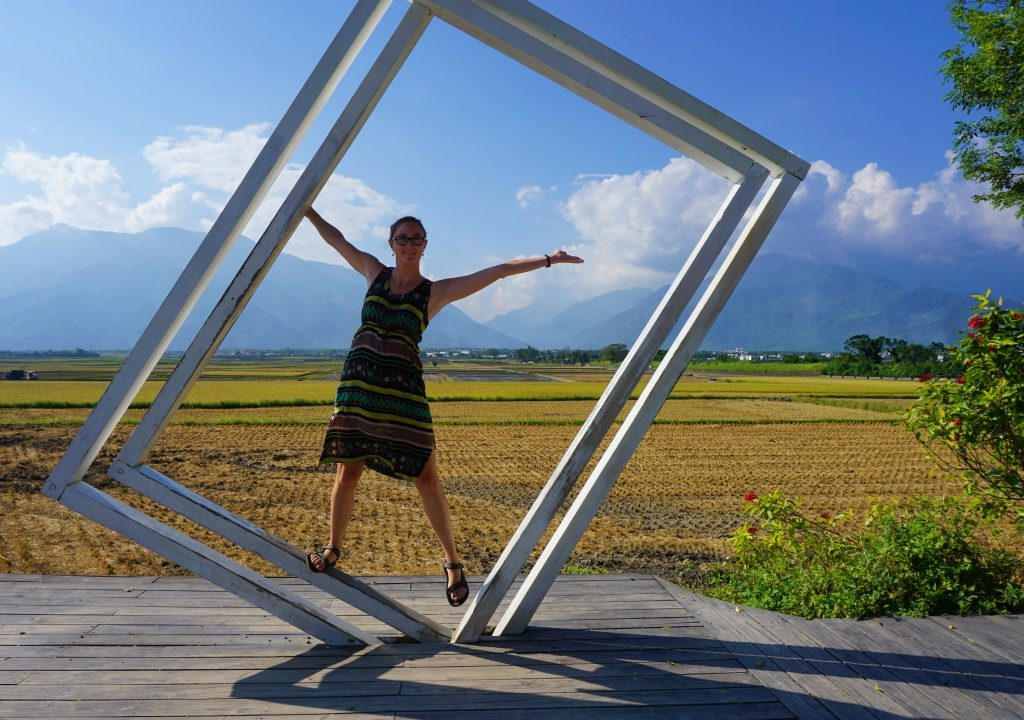 Girl posing at a picture frame at rice fields of Fuli, Hualien, Taiwan