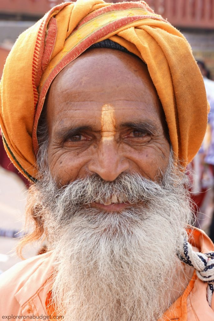 an old man in traditional clothes is a typical example of beggers in Indian culture